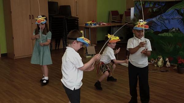 Gina Giraffe and friends balancing feathers